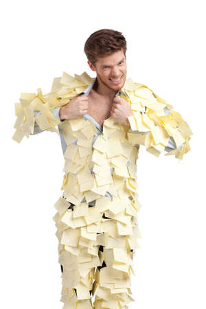 The young male covered with yellow sticky notes, isolated on white background Stock Photo