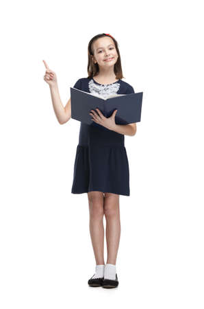cheer full: Schoolgirl with opened book smiles, isolated, white background Stock Photo