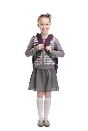 Smart pupil is ready to go to school, isolated, white background photo