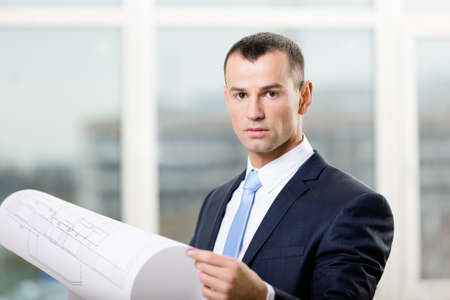 architecting: Engineer wearing suit and necktie hands layout