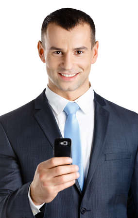 Businessman in suit and blue tie taking pictures with phone, isolated on white photo