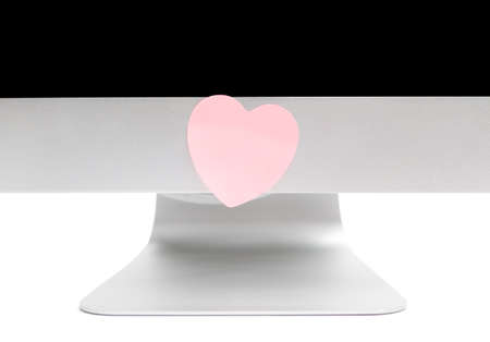 assert: Computer with a sticker in the shape of a heart
