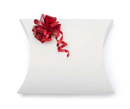White gift box with red ribbon, isolated on white. Symbol of celebration and happy holiday photo