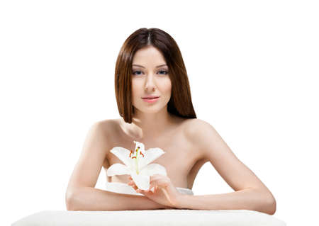 Woman in towel with flower of white orchard, isolated on white photo