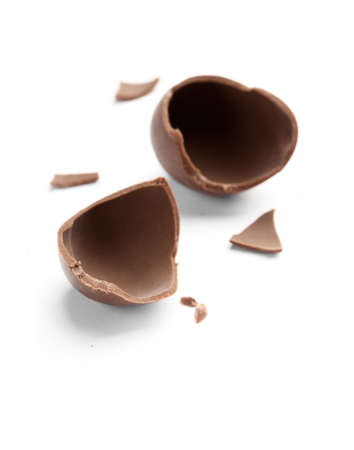 the feast of the passover: Broken into pieces sweet chocolate egg, isolated on white
