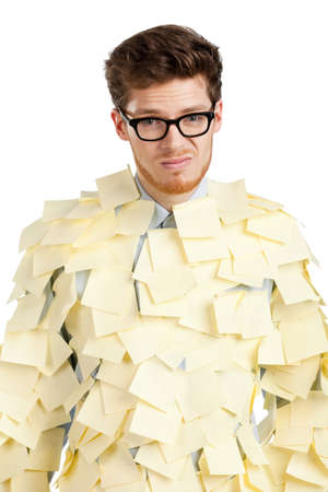 Sad young man with a glasses covered with yellow stickers, isolated on white background photo