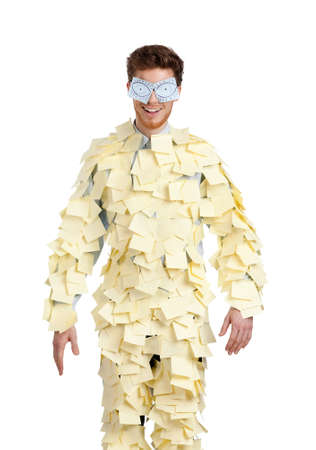 assert: Young man with eyes painted on stickers, covered with yellow sticky notes Stock Photo