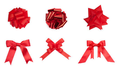 Collection of different red colored bows, isolated on white. Symbol of party and happy holiday Stock Photo - 18303455