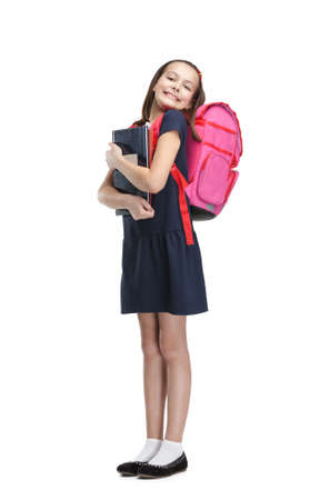 Joyful schoolgirl with the briefcase is happy to study, isolated, white background photo