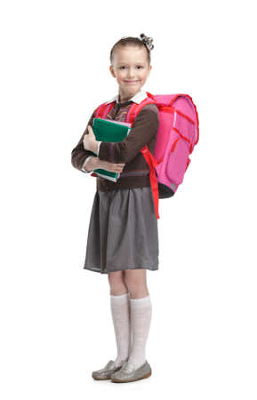 cheer full: Pupil with suitcase and exercisebooks is ready to go to school, isolated, white background