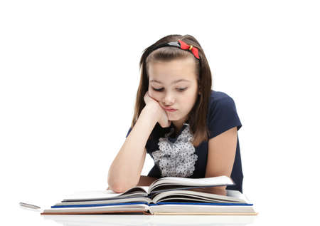 Schoolgirl is tired of studying, isolated, white background photo