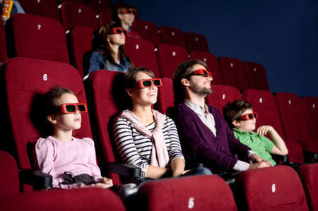 Parents with children enjoying time at the cinema photo