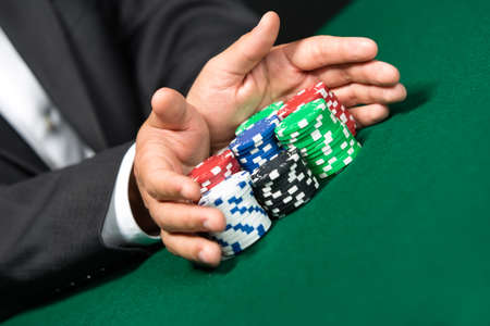 Gambler stakes all in pushing his chips forward. Risky entertainment of gambling photo