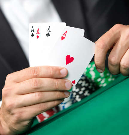 gambler: Gambler shows poker cards 4 aces. Challenge to the casino