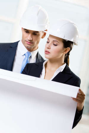 architecting: Two engineers looking at the sketch and discuss their cooperation Stock Photo