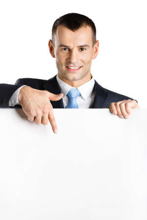 Businessman points with hand at paper copy space, isolated on white Stock Photo - 18337917