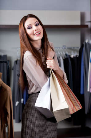 keeps: Woman keeps paper bags Stock Photo