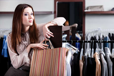 Satisfied with purchases woman carries paper bags with presents Stock Photo - 18338307