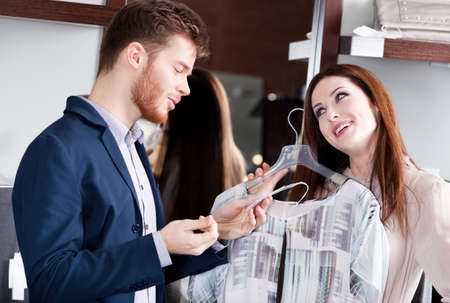 Couple is amazed with special prices on the clothes Stock Photo - 18338295