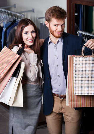 Satisfied with prices couple does shopping photo
