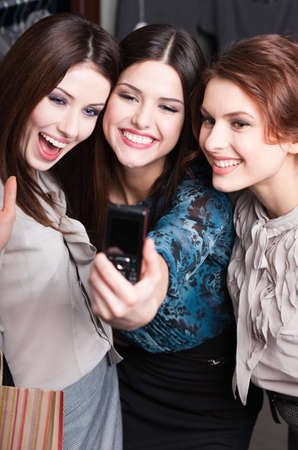 Three pretty girls take photo after shopping at the mall Stock Photo - 18338552