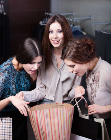 Girls wonder the purchases of their friend photo