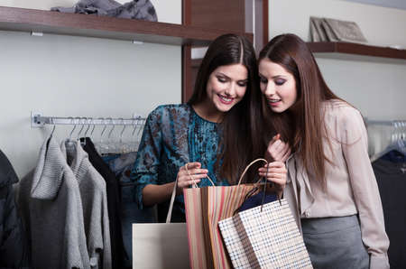Two girlfriends buy presents in a sale photo