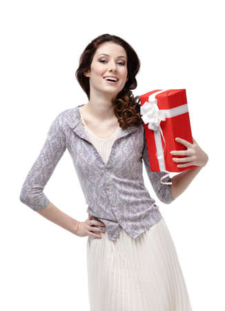 Young woman is glad to receive a gift wrapped in red paper, isolated on white Stock Photo - 18574363