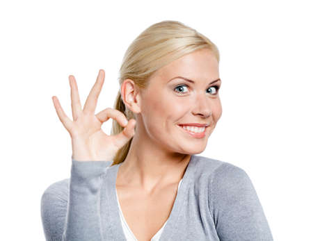 Portrait of woman okay gesturing with one hand, isolated on white photo