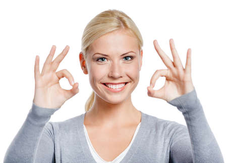 Portrait of woman okay gesturing with two hand, isolated on white photo