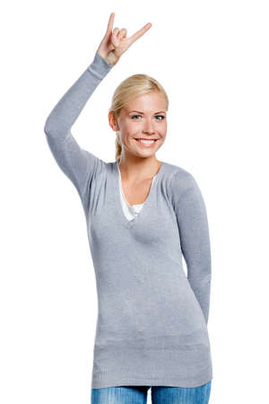 Lady gesturing rock sign with hand, isolated on white Stock Photo - 18500825
