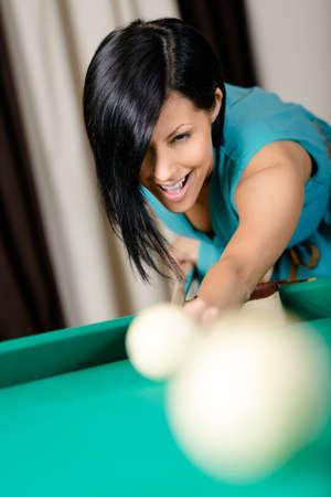 Woman playing billiards. Spending free time on gambling Stock Photo - 18500776