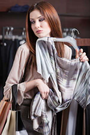 tries: Woman tries the dress on Stock Photo