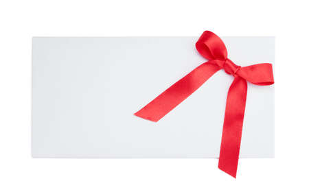 Blank card tied with a bow of red ribbon, isolated on white. Symbol of party and happy holiday photo