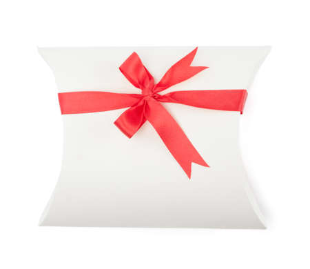 White gift box with scarlet ribbon, isolated on white. Symbol of party and happy holiday photo