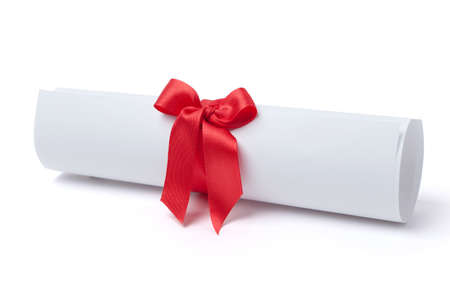 Graduation diploma scroll tied with red ribbon, isolated on white. Symbol of successful graduation photo