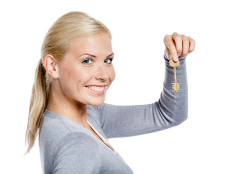 Woman in gray sweater keeps a key, isolated on white photo