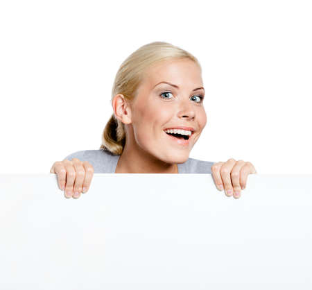 Girl keeping huge sheet of white paper, isolated on white, copyspace Stock Photo - 18915860