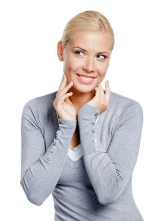 grigiastro: Esaminare femmina il suo viso e le rughe che possono comparire, isolato su bianco Archivio Fotografico