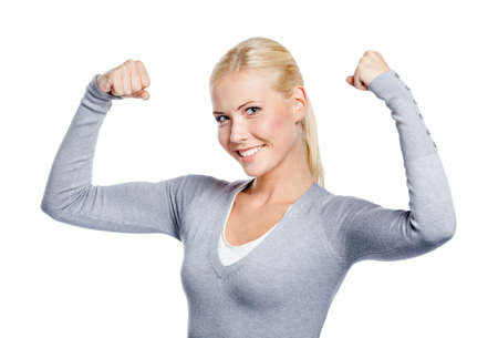 showing muscles: Woman in grey sweater showing her strong muscles, isolated on white Stock Photo