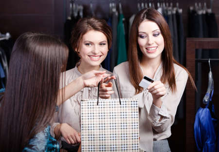 Pretty women pay a bill with credit card photo
