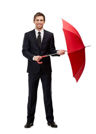 Full length portrait of businessman with opened red umbrella, isolated on white photo