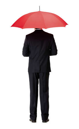 Back view of man in suit with opened red umbrella, isolated on white photo