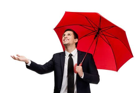 Palming up man with umbrella checks the rain, isolated on white photo