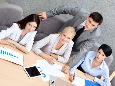 office presentation: Business people at the presentation discuss current issues at the modern office building. Team achievement Stock Photo