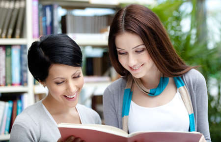 adult intercourse: Two female students read books at the library hall