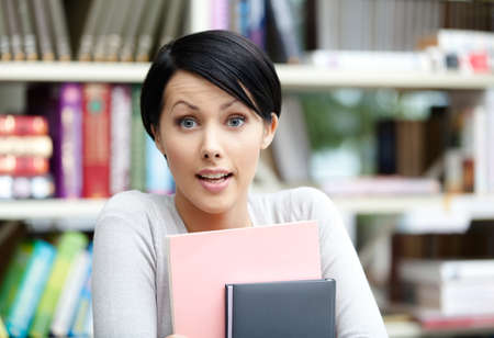 Female student with book at the library. Education and self-development photo