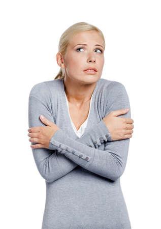 tremble: Half-length portrait of freezing girl , isolated on white Stock Photo