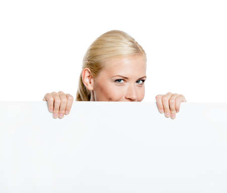 Girl looks out of the huge sheet of paper - copyspace for the text, isolated on white Stock Photo - 19411405