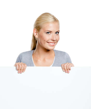 Woman keeping huge sheet of white paper, isolated on white, copyspace Stock Photo - 19411395